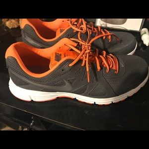 Men's size 13 Nike Revolution 2 tennis shoes.